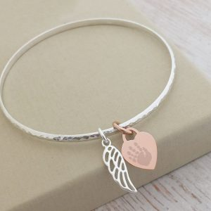 Sterling Silver Hammered Bangle With Rose Gold Print Charm & Cutout Wing