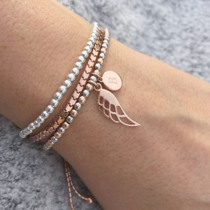 Two Tone Ball Slider Bracelet With Rose Gold Wing & Engraved Disc